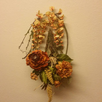 Floral wall swag arrangement. Teardrop wall hanging rustic,country feel with warm comforting colors.
