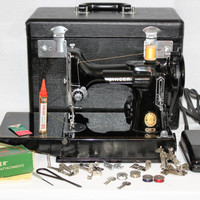 Vintage Singer 221 Portable Featherweight Sewing Machine and Carrying Case.  Serial # AM691697