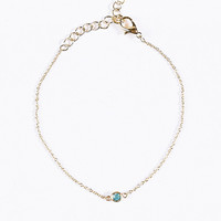 Tiny Green Stone Bracelet in Gold - Urban Outfitters