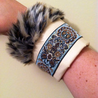 Leather and faux leapord fur cuff bracelet. High fashion fabulous! Handsewn.