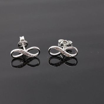 INFINITY stud earrings in silver by bythecoco on Zibbet