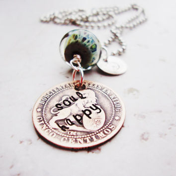 Soul happy hand stamped old coin necklace with peace charm and boro glass