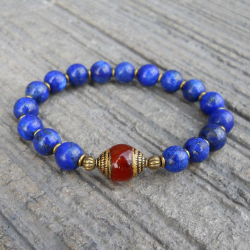 compassion - genuine lapis lazuli gemstone mala bracelet with a Tibetan capped carnelian guru bead, thicker version