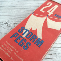 An original mid century vintage packaging with 22 wooden clothes pegs. Bold red 1960s packaging design.