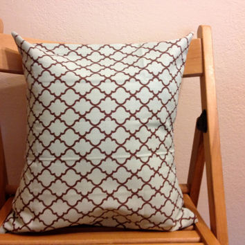 Light blue-green and brown patterned throw pillow