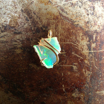 african opal shard tension set in hand forged polished 14 karat gold