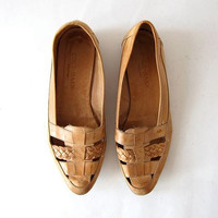 vintage leather leather flats. braided woven slip ons. cut out sandals.