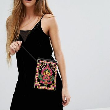 Reclaimed Vintage Embroidered Cross Body Bag at asos.com