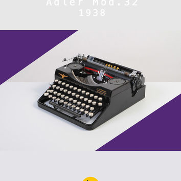 RESERVED /// Rare 1938 Adler model 32. Restored and fully functional. Glossy black with glass keys. Portable. With Case.