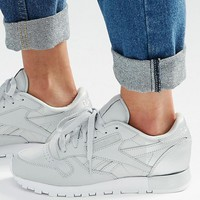 Reebok Classic Sneakers With Metallic Heel Detal at asos.com