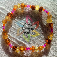 Baby Baltic Amber Bracelet/Anklet designed with 100% Baltic amber multicolored round beads, orange and purple accent glass beads.