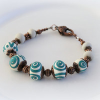 Ivory lampwork bracelet with petrole green drawing Art glass jewelry Artisan handmade lampwork bracelet Ethnic style Rustic Organic