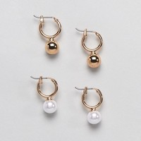 Monki 2 Pack Pearl and Ball Stud Hoops at asos.com