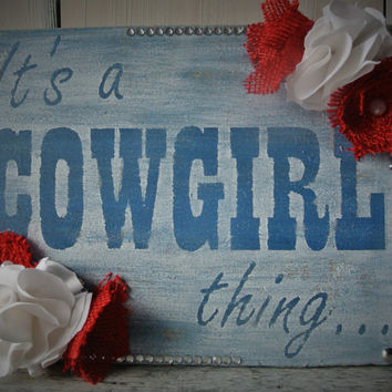 Rhinestone Cowgirl Distressed Sign. Red, White, and Blue with embellished fabric and burlap flowers.