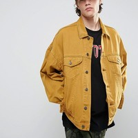 ASOS Oversized Denim Jacket In Vintage Yellow at asos.com
