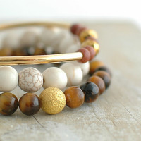 Bohemian stacking bracelets, goldstone & cream magnesite w/ gold stardust beads and metallic accents, semiprecious bead stretch bracelets