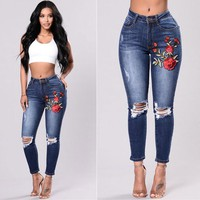 Women Fashion Worn Ripped Embroidery Flower Bodycon Jeans Trousers