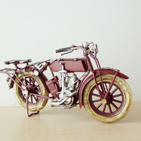 Retro motobike replica, metal collectible motorbike in oxblood red