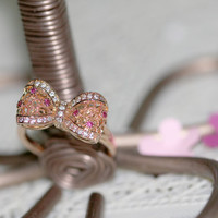 Gorgeous Ribbon ring/Rose gold plated/Classy and Lovely/Depending on the light sparkles is a small Ruby cubic /Adjustable