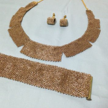 Peyote stitch gold coloured jewelry set.  Seed beads. . Cleopatra design. Gold plated..Peyote earings. Peyote cuff. Peyote necklace.