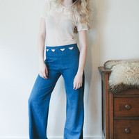 Starlight - wide legged denim blue jeans with high waist and cutouts