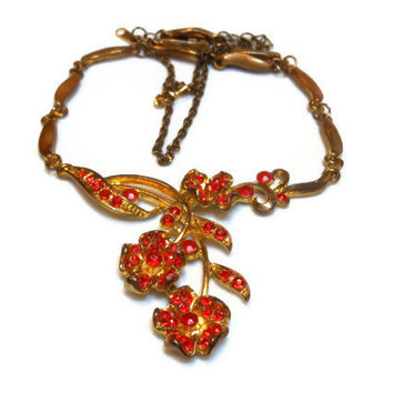 Dramatic faux red rhinestone gold tone floral necklace with extender.