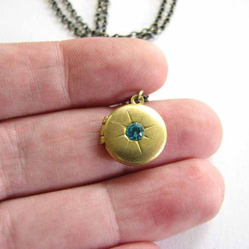 tiny locket necklace with aqua blue crystal rhinestone starburst - vintage round locket  - small brass locket jewelry