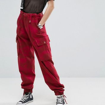 Reclaimed Vintage Revived Over-Dye Camo Trousers at asos.com