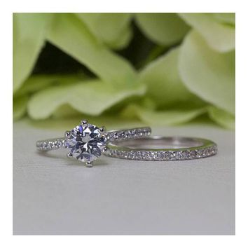 Sterling Silver 0.75 Ct. Round Brilliant Cubic Zirconia Half Eternity Band Engagement Ring Set