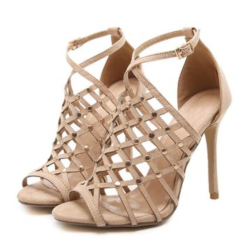 Stiletto heels with a criss cross rivet design & ankle strap