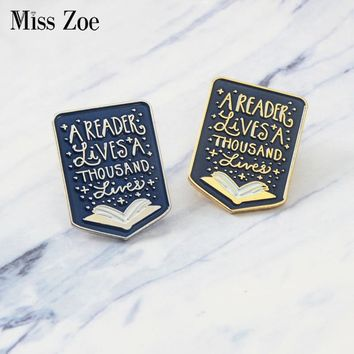 Book enamel pin Quote A reader lives a thousand lives Brooch Badge Lapel pin Denim Clothes cap bag Gift for Booklover Kid friend