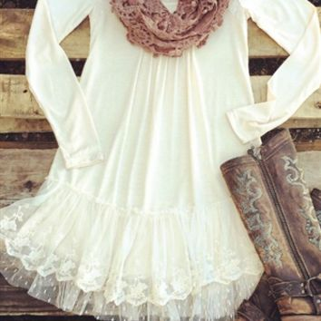 Long sleeve lace dress with a double ruffle at the bottom.