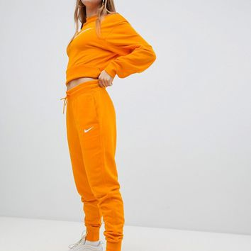 Nike Exclusive To ASOS Orange Joggers at asos.com