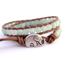 Double wrap leather bracelet. Light green blue beaded jewelery. Lucky elephant button.