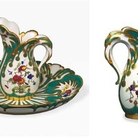 A SEVRES GREEN GROUND FOLIAGE-MOULDED EWER AND BASIN (<I>BROC ET JATTE FEUILLE D'EAU, 1<V>E<V>R<V>E GRANDEUR</I>), BLUE INTERLACED L'S ENCLOSING DATE LETTER G FOR 1759/1760 TO EACH, THE PAINTING ALMOST CERTAINLY BY CHARLES-NICOLAS DODIN