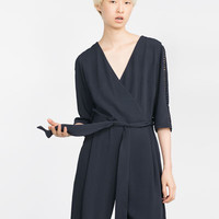 LONG CROSSOVER JUMPSUIT