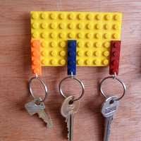 Yellow Lego key organizer  with 3 key holders and Velcro Sticky Back tape to stick to most items.