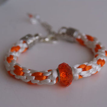 White and Orange Braid Kumihimo Bracelet. Satin Cord Rope Bangle with Sparkly Acrylic Bead Centered.