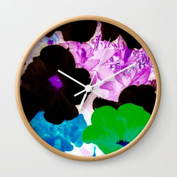 neon flower Wall Clock by violajohnsonriley