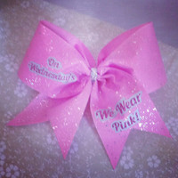 Large cheer bow on pony. On Wednesdays we wear pink