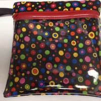 "Vinyl see through padded zippered case is versatile and is 7 1/2"" x 7 3/4"". Black cotton material with bright circles in various colors."