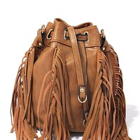 This street-chi crossbody drawstring bucket bag features a vegan leather with 4 panel fringe detailing, self-tie closure, matching material shoulder strap, gold tone hardware, finished with one interior zipper pocket and two unzip pockets, fabric lining. C