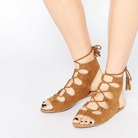 Boohoo Lace Up Sandal With Tassel at asos.com