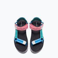 Crossover track-soled sandals