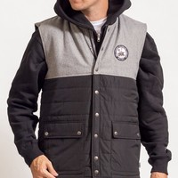 the Pintail Puffer Vest in black and grey