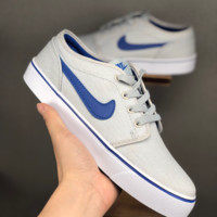 HCXX 19June 1059 Nike Toki I Low Cool canvas sneakers