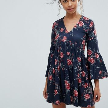 ASOS PETITE Smock Dress With V Neck and Trumpet Sleeve In Rose Print at asos.com