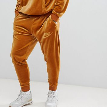 Nike Velour Joggers In Gold AH3388-722 at asos.com