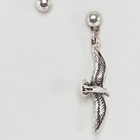 Reclaimed Vintage inspired earrings with bird charm exclusive at ASOS at asos.com