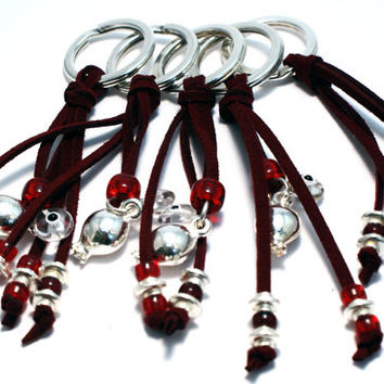 "Good luck ""gouri"" key chain with silver plated pomegranate, dark red suede cord, glass and silver plated beads and evil's eye"